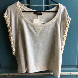 Oatmeal/gray colored crop top with shell accents